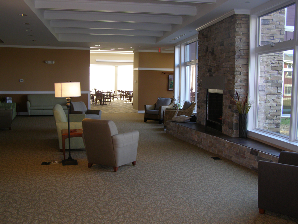 The Grand Room offers a cozy setting where guests can relax by the fire and enjoy the view of the river.