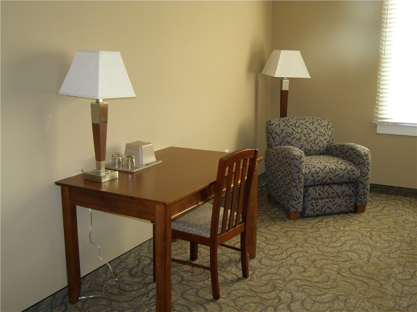 Each room also features a desk and easy chair.