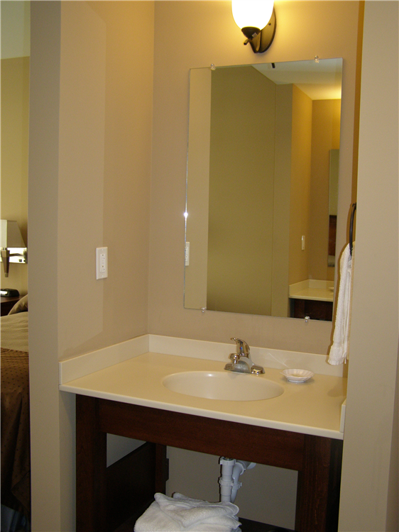 Rooms also include an in-room bathroom, and vanity sinks outside of the bathroom.
