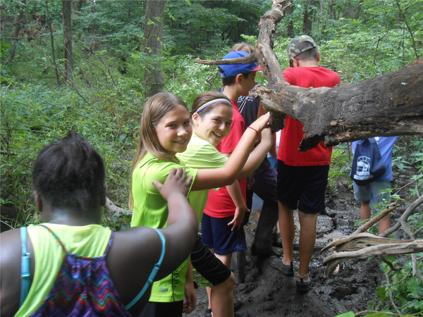 Campers explore wooded trails and learn about nature.