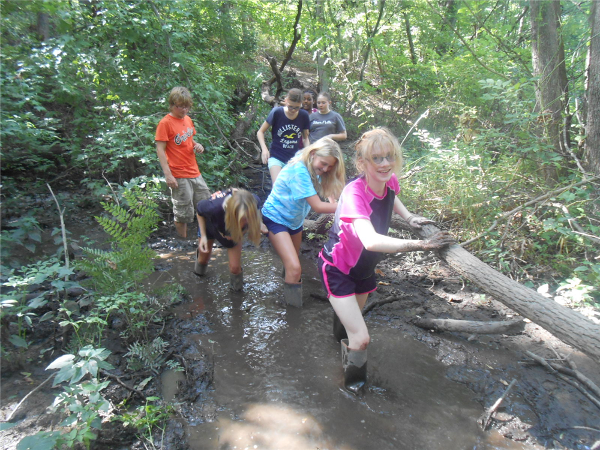 Campers explore wooded trails during Nature Discovery - sometimes it gets a little messy!