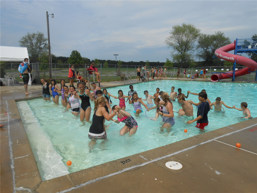 Riverside Campers campers compete in their cabin groups during Pool Olympics!
