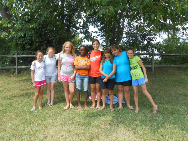 Group photos are taken of each cabin group and posted on Bunk 1 for parents and campers to see.