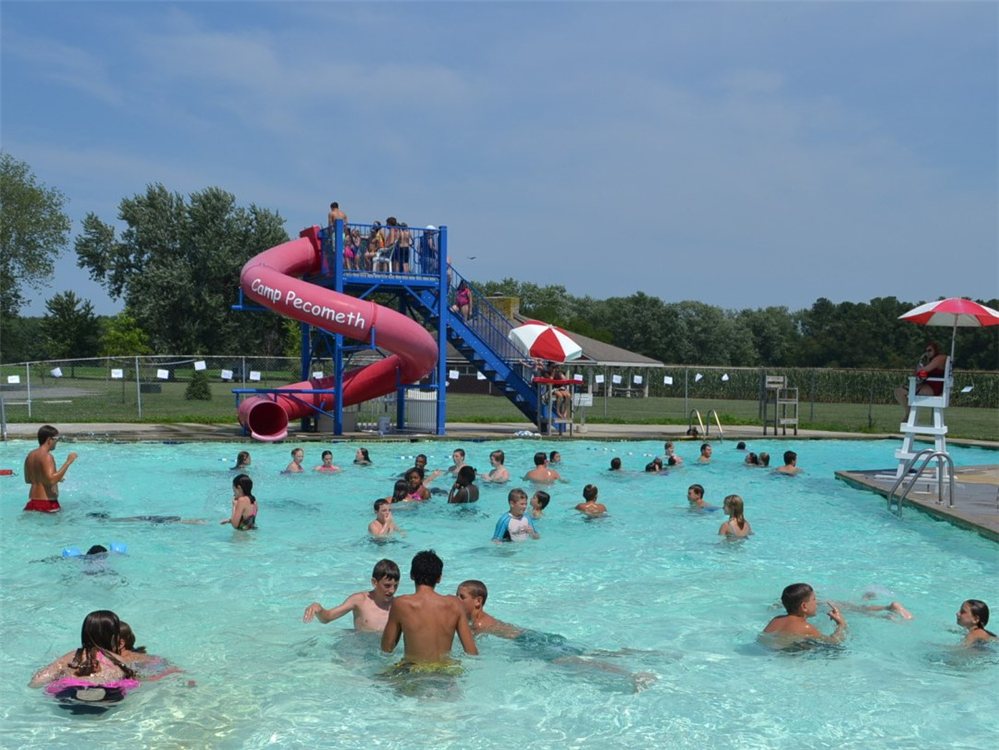 Campers swim at the pool and enjoy the ever-popular water slide!