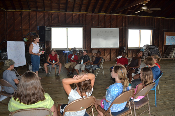 Campers pause from fun in the sun each day for Bible study led by local volunteer pastors.