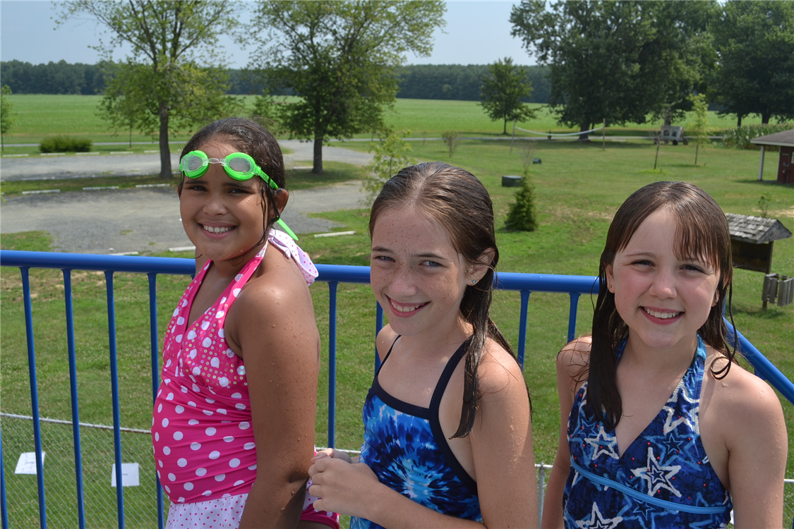 Campers enjoy the view while waiting for their turn to go down the slide at the pool.