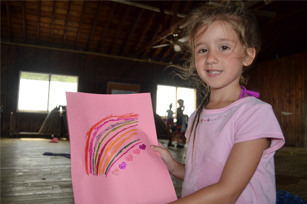 A camper shares the picture she drew in Bible study.
