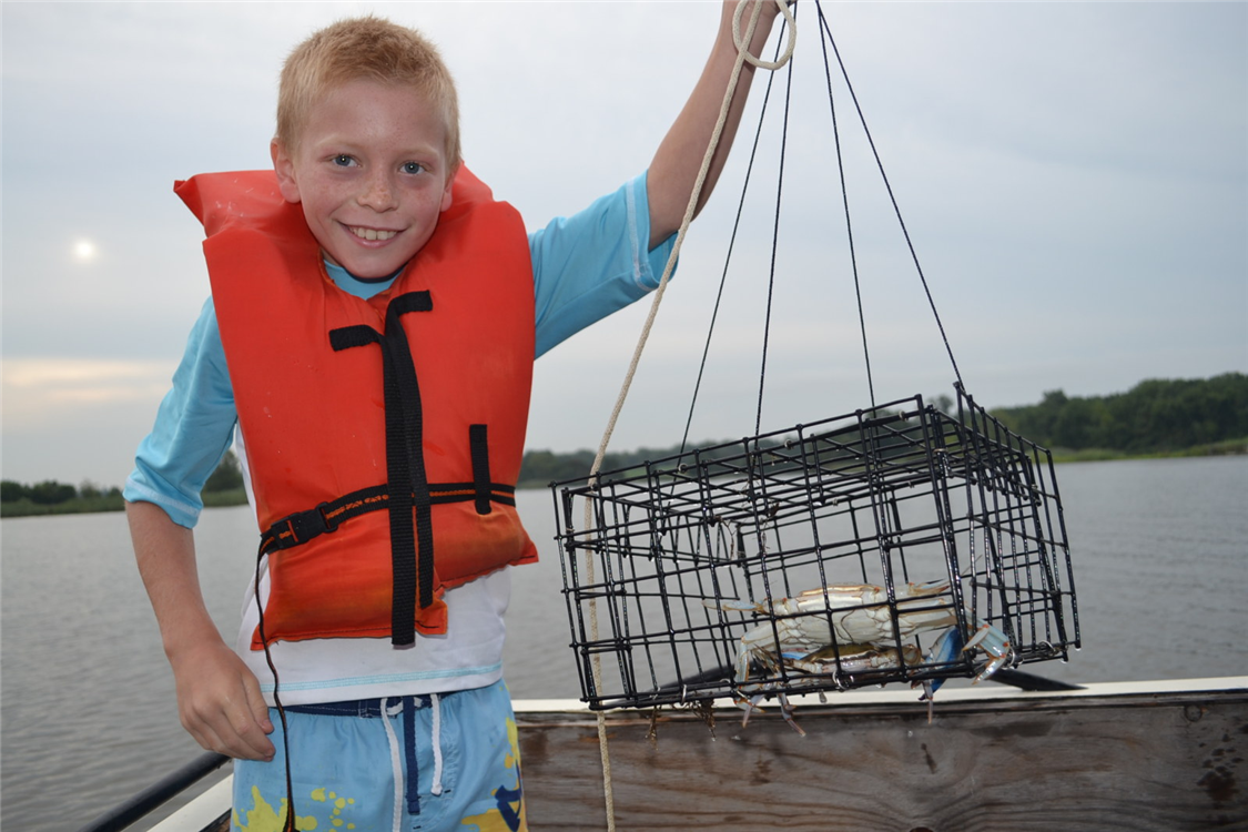 Chester River Trek campers get up early in the morning to go crabbing - and on Thursday celebrate with a crab feast!