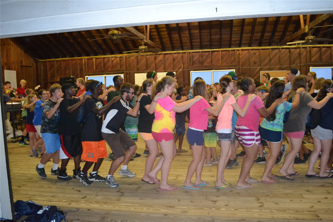 Campers and staff get up and dance during Music Time each evening.